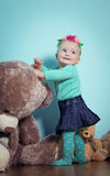 Little girl is playing with toys. Stock Photography
