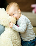 Little girl playing with toys stock photography