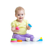 Little girl playing with toys isolated stock images
