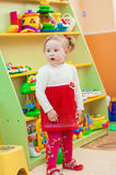 Little girl playing with toys in  playroom Stock Photography