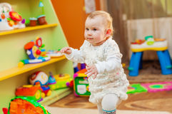 Little girl playing with toys in  playroom Royalty Free Stock Images