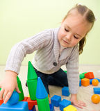 Little girl is playing with toys in preschool Stock Image