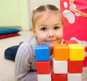 Little girl is playing with toys in preschool Royalty Free Stock Photo