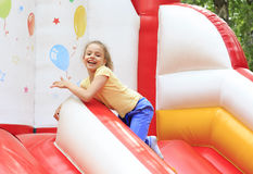 Little girl playing on a trampoline. Stock Photo