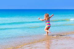 Little girl playing on tropical beach Royalty Free Stock Image