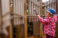 Little girl playing tubular bells Stock Photo