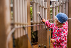 Little girl playing tubular bells Stock Photos