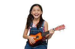 Little girl playing ukulele with smile Stock Photography