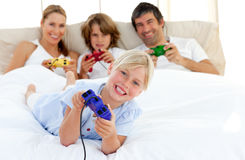 Little girl playing video game with her family Royalty Free Stock Images