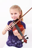 Little girl playing violin Royalty Free Stock Images