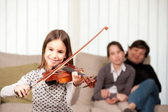 Little girl playing violin Royalty Free Stock Photos