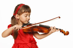 Little girl playing violin Stock Photos
