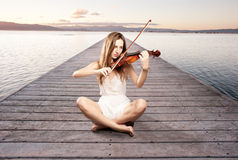 Little girl playing violin Stock Photography