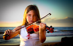 Little girl playing violin Stock Images