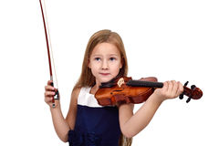 Little girl playing the violin o Royalty Free Stock Photos