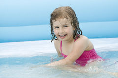 Little girl playing in water Royalty Free Stock Photography
