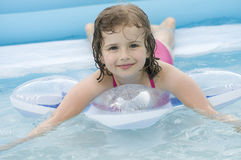 Little girl playing in water stock photography