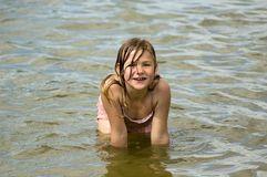 Little girl is playing in the water Royalty Free Stock Image