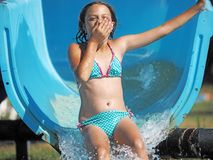 Little girl playing in a water park royalty free stock image