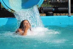 Little girl playing in a water park stock photography