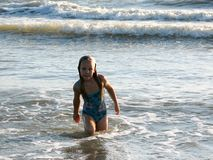 Little girl playing in the waves. At sea on a sunny day Stock Photo