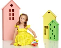 Little girl playing. With a whirligig.  on white background Royalty Free Stock Images