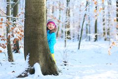 Little girl playing in winter forest Royalty Free Stock Photos