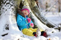 Little girl playing in winter forest Royalty Free Stock Image