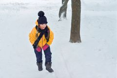 Little girl playing on a winter hill stock images