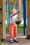 Little Girl Playing With A Thick Sport Rope Royalty Free Stock Photos