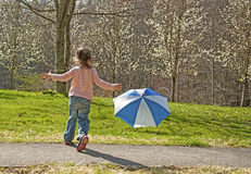 Free Little Girl Playing With An Umbrella. Stock Photos - 33328623