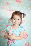Little Girl Playing With Her Knitted Toys Stock Photo