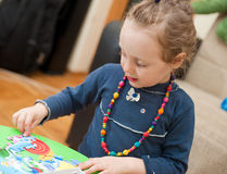 Little Girl Playing With Puzzle 2 Royalty Free Stock Image