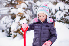 Free Little Girl Playing With Red Shovel In The Garden Royalty Free Stock Photo - 37941695