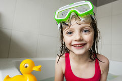 Little Girl Playing With Toys In A Bath Stock Photos