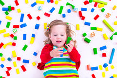 Little girl playing with wooden blocks Royalty Free Stock Image