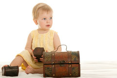Little girl playing wooden chests Royalty Free Stock Images