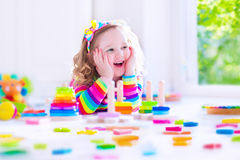 Little girl playing with wooden toy blocks Royalty Free Stock Photography