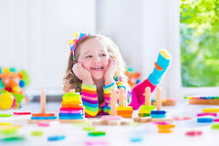 Little girl playing with wooden toys Royalty Free Stock Photography