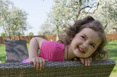 Little girl playing at the yard royalty free stock photo