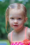 Little Girl Playing in the Yard. Little Girl Wearing Pink Bathing Suit Playing in the Yard Stock Photo