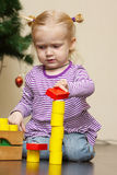Little girl playng with toy blocks Stock Image