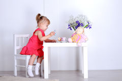 Little girl plays Stock Image