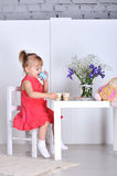 Little girl plays Royalty Free Stock Photos