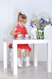 Little girl plays Stock Photography