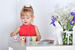 Little girl plays Stock Photos