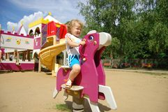 The little girl plays attractions Royalty Free Stock Photo