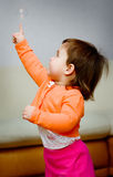 Little girl plays with bubble Stock Photo