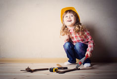 Little girl plays in the builder Stock Photos
