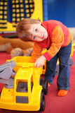 Little girl plays with car in kindergarten Royalty Free Stock Photo